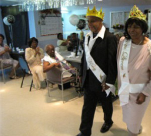 New Community Adult Medical Day Care staff  organized a Senior Prom where Donald Red, left, and  Dorothy Ards, right, were crowned as senior prom king  and queen, respectively, by a plurality of votes cast at  the celebration.