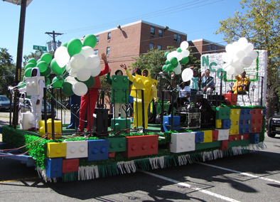 "NCC headquarters used the theme ""Building Communities Block By Block"" for its float using Legos. Parade king and queen, Raymond Mohabir of Hudson Senior and Edwina Smith of Commons Senior, waved to onlookers from the float, along with several Lego characters."