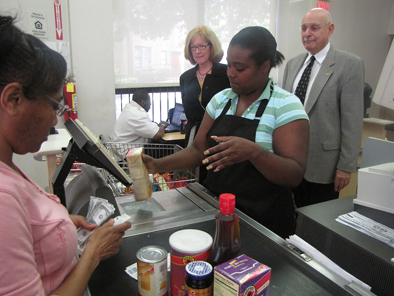 A file photo of a trainee in New Community's Gateway-To-Work Supermarket Career Program practices cashiering at the ShopRite training facility housed at NCC.