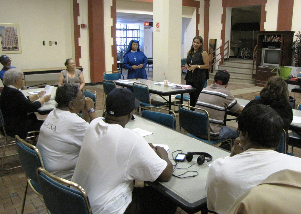 Milda Rosa, standing center, a Community Educator with New Jersey Citizen Action, spoke to seniors at NCC Douglas Homes about how to guard against identity theft, scams and fraud.