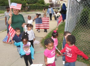 As a simple but visible tribute, students and staff from NCC Harmony House Early Learning Center honored the victims of Sept. 11, 2001, by marching in Newark on the 13th anniversary of the terrorist attacks.