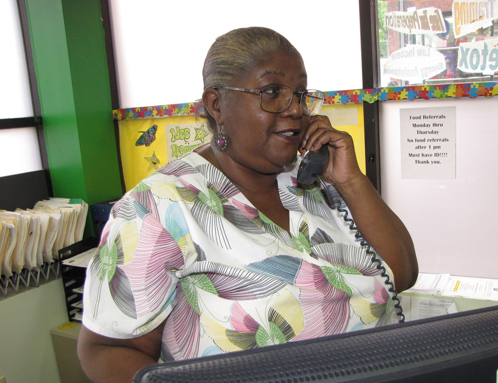 Denise Swiney, a Certified Nursing Assistant at New Community Extended Care Facility, volunteers at the NCC Family Resource Success Center where she mans the phone, helps clients fill out forms and assists wherever she is needed.