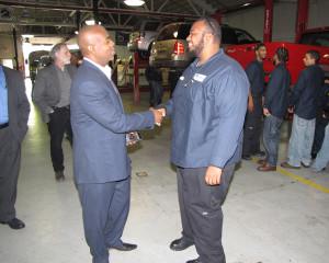 Newark Mayor Ras Baraka visited three New Community programs, including the Workforce Development Center's Automotive Technician Employment and Training Program at 210 West Bigelow St. Trainee Dejon Thompson, right, shakes hands with Baraka.