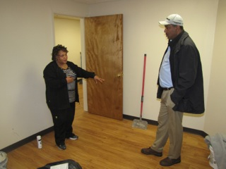 Sharon Pleasant-Jones, left, Director of Health and Social Services, points out the area where the patient exam table will be in the new clinic at NCC Commons Senior to Environmental Services Director Wayne Gravesande, right.