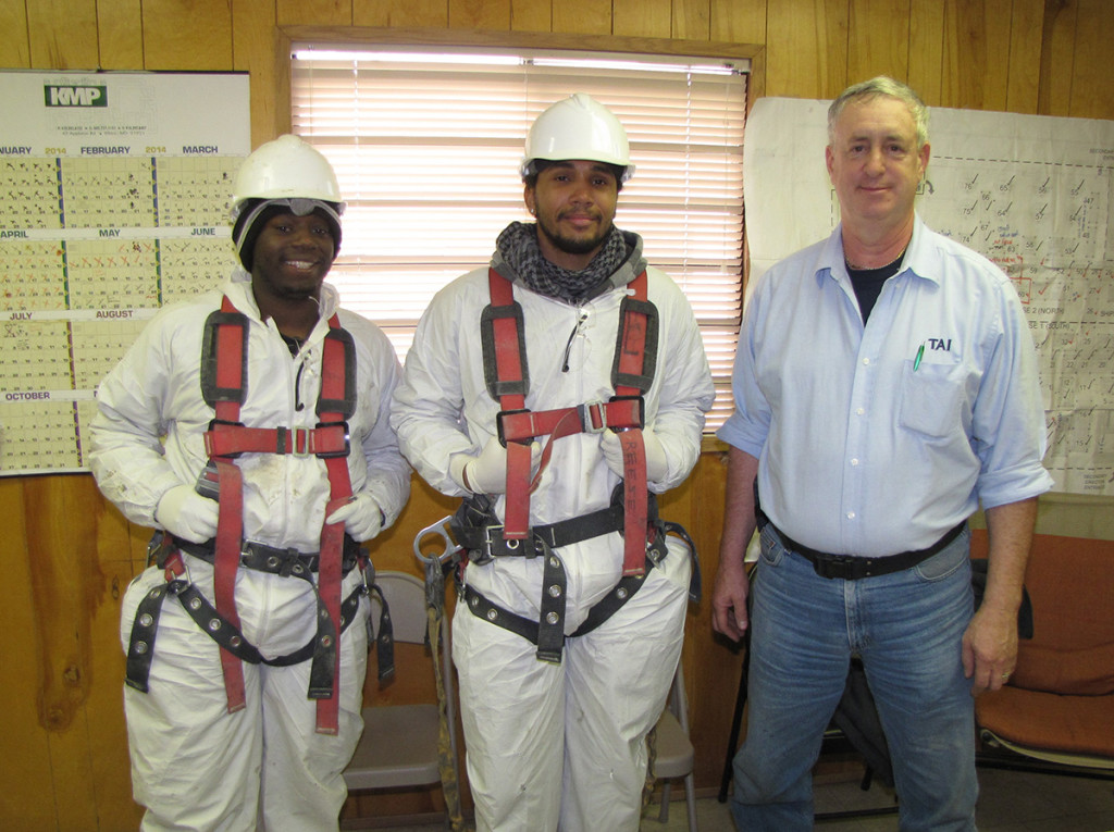 From left: NCC Building Trades Training Program students Maurice Culley and Emiliano Jones stand with their supervisor, George Finch, Fiberglass and Coatings Division Manager for TAI Specialty Construction, at their work site in South Kearny.