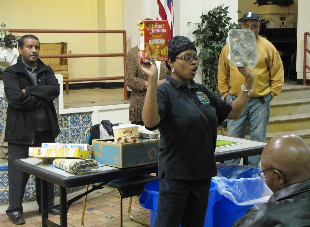 Recycling Coordinator Brenda Anderson from the City of Newark shows two examples of paper products that must be recycled: an empty box of pancake mix and a cardboard drink tray.