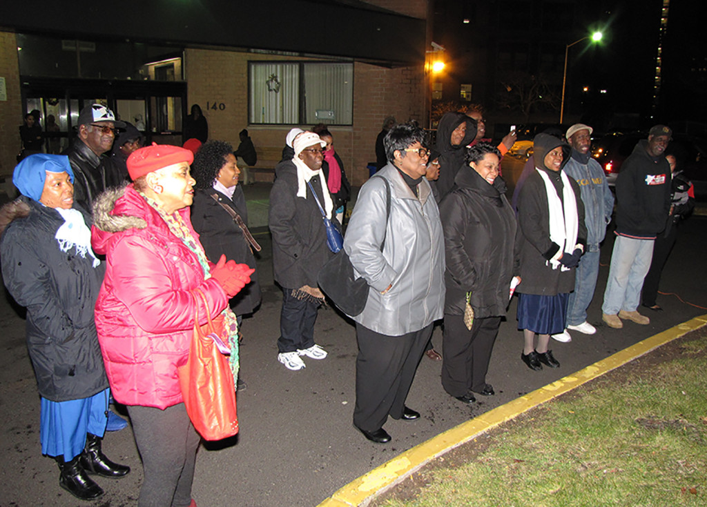 The New Community Gospel Choir led the singing of Christmas carols at NCC Commons Senior's annual tree lighting at 140 South Orange Ave. in Newark. Building residents and the NCC Health and Social Services Department also participated.