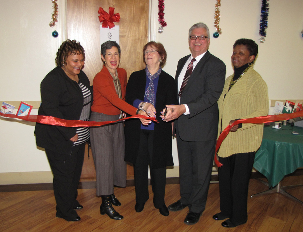 Officials gathered to cut the ribbon of New Community Commons Senior's new health clinic. From left: Sharon Pleasant-Jones, NCC Director of Health and Social Services, Lisa Block, Senior Program Officer at The Healthcare Foundation of New Jersey, Marsha Atkind, Executive Director at The Healthcare Foundation of New Jersey, Richard Rohrman, New Community CEO, and Kathy Spivey, NCC Chief of Staff.