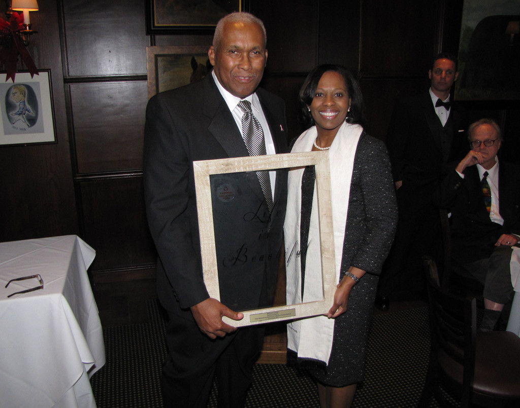 Frances Teabout, right, NCC Director of Mission, accepted the award on behalf of Monsignor William J. Linder, founder of New Community, at the gala on December 8. Teabout is standing next to Henry Rawls, founder of the Nubian Cultural Center.