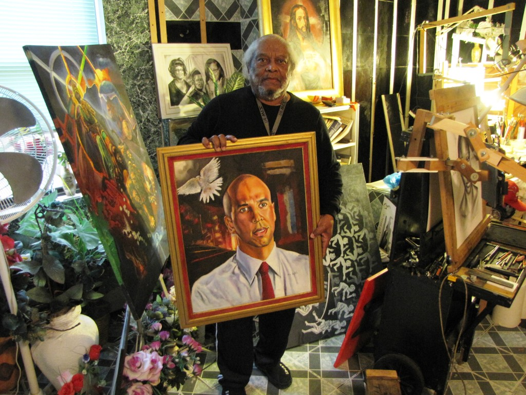 John Aytch, a resident of NCC Gardens Senior, holds a portrait of U.S. Sen. Cory Booker that he painted during Booker's earlier years as mayor of Newark.