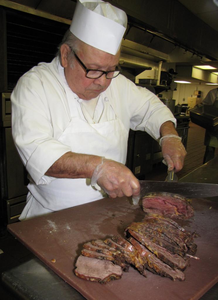 Kitchen Joe Rodriguez slicing roast