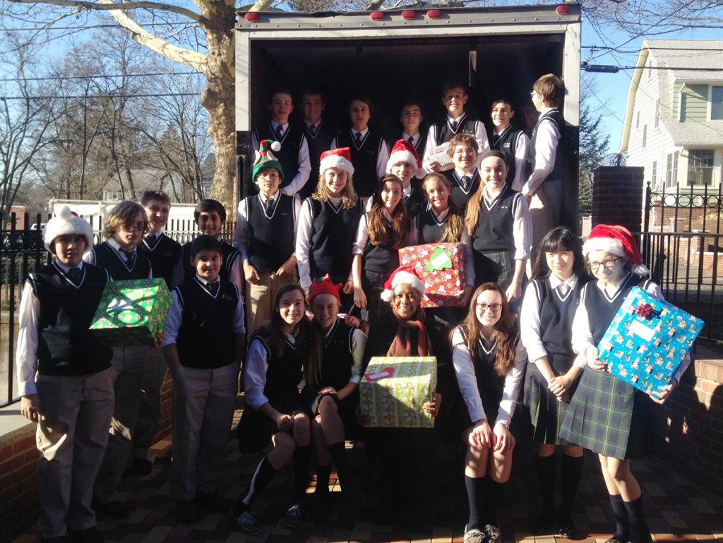 Students from St. Rose of Lima Academy in Short Hills filled the truck with gifts and surrounded Madge Wilson, seated first row.