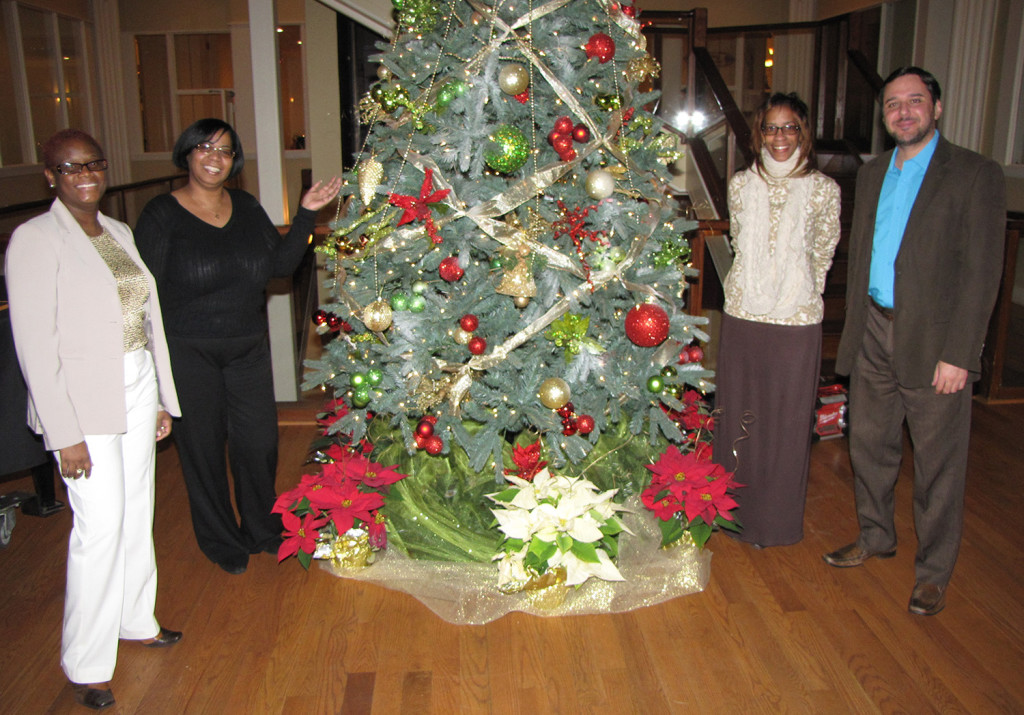 O Christmas Tree! From left: Anna Sing-King, Manager of Human Resources, Jackie Andrews, Program Manager of SAIF, Lisa Chavis, Senior Case Manager at Harmony House, and Cristhian Barcelos, Director of the NCC Adult Learning Center.