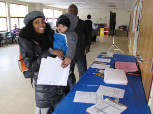 CHELC financial planning parent with child at registration