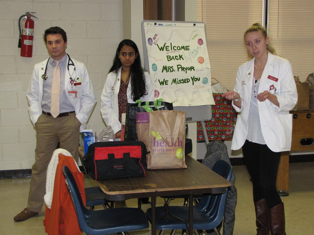 Harmony House med students speaking