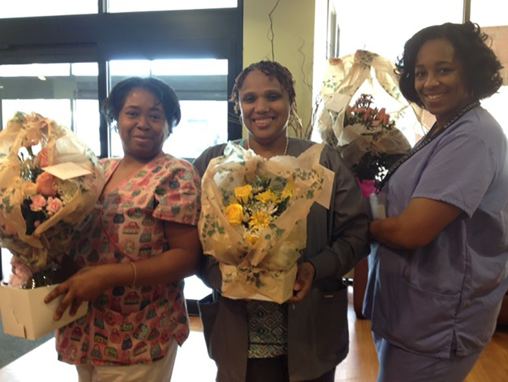 Three nurses from the Extended Care Facility received perfect scores during their medication administration reviewed by the New Jersey Department of Health during the nursing home's certification survey from February 11 to February 20. From left: Sheila Coleman, Robyn Moses and Maria Cruz all received flowers for their successful efforts. Photo courtesy of Robert Smolin.