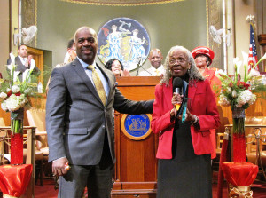 Newark Mayor Ras Baraka, left, with New Community Associates resident Elnora Haynes, right, as Haynes receives the Unsung Heroes and Heroines Award in the Municipal Council Chambers at City Hall on May 4, 2015.