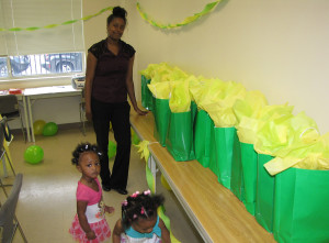 Antoinette Dixon, program manager of New Start, smiles next to gift bags prepared for each New Start mother.
