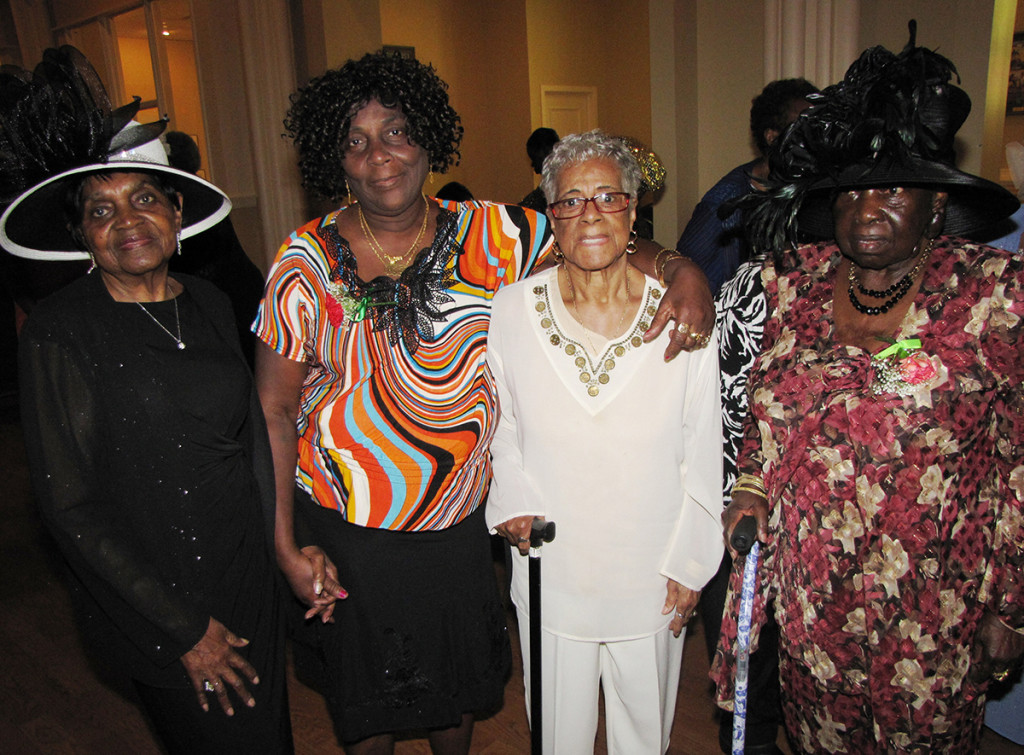 Contest winners, from left: Jameelah Martin (best hat), Walterine Hatton (most children, 12), Pearl Nickerson (oldest mother, age 90), and Anna Sherman (best dress).