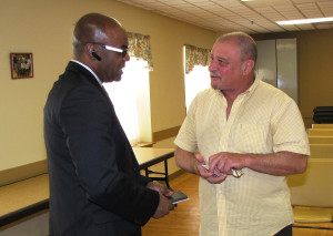 Atanasildo Fleitas, right, a resident of Orange Senior, discussed his questions with Rodd Henson after the presentation.