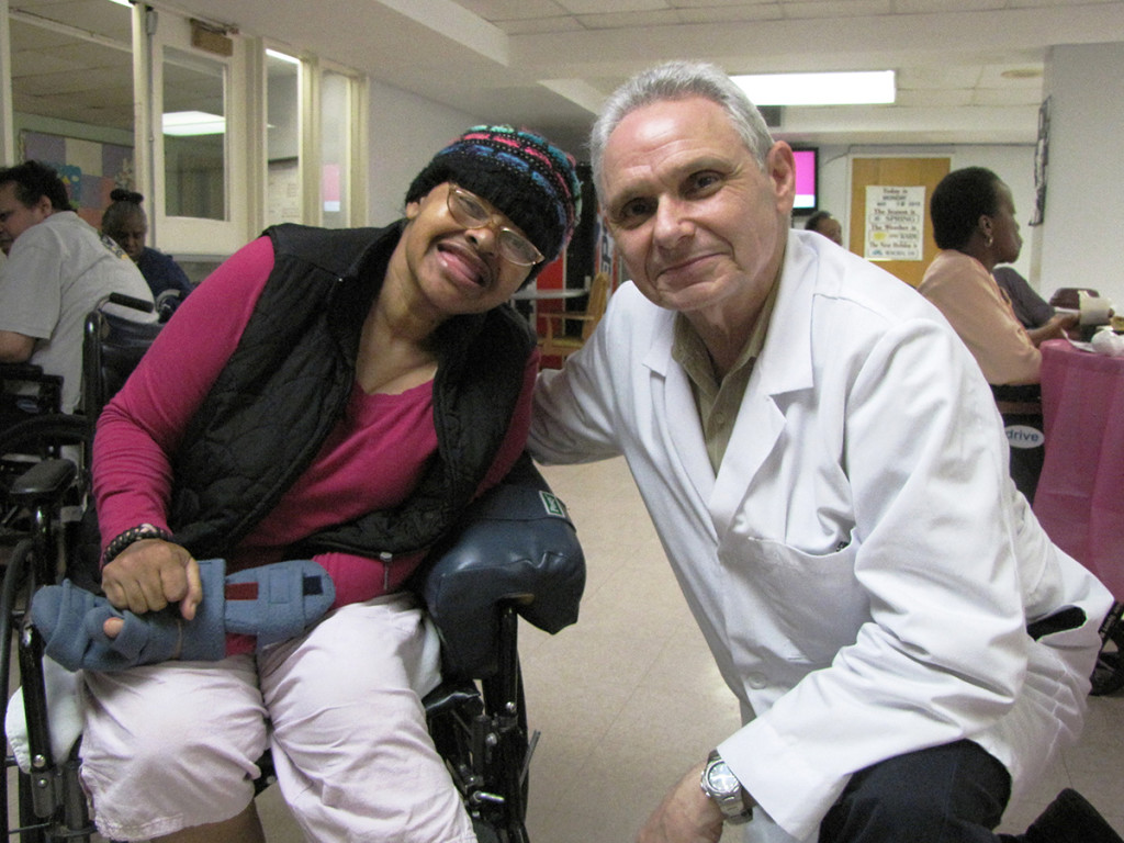 Crystal McCoy, left, a resident of New Community Extended Care, with podiatrist Dr. Robert Kosofsky.