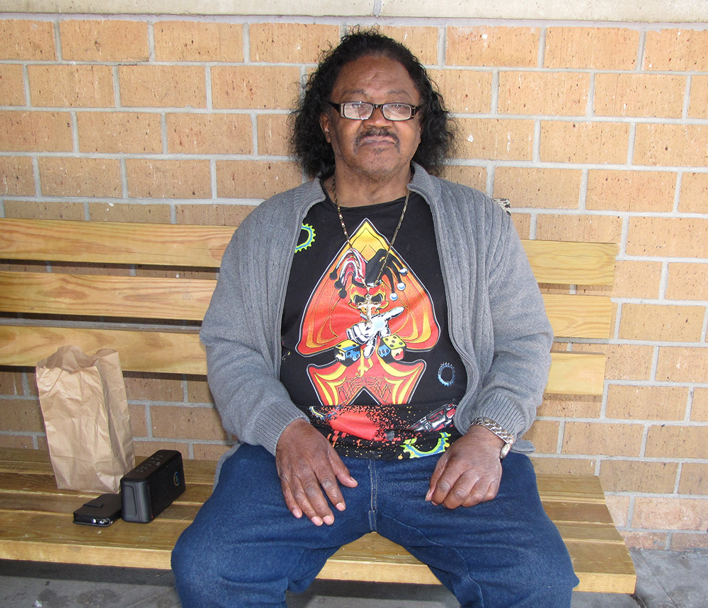 Claude Goodson can often be found perched on a bench at New Community Commons Senior with music playing from his portable speaker.