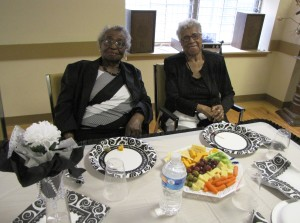 New Community Orange Senior residents Gloria Forde, left, and Pearl Nickerson enjoyed appetizers including crackers, cheese, olives, vegetables and fruit.