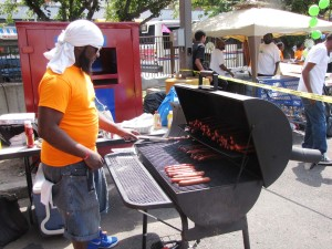 Derek White volunteered to man the grill at Harmony Day and served up hot dogs for those who attended the resource fair.