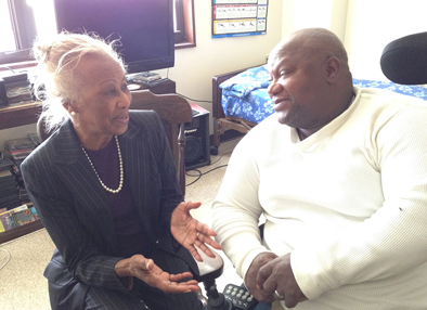 Madge Wilson, left, visits Vietnam veteran Nathaniel Lawrence at his apartment at New Community Associates in Newark.