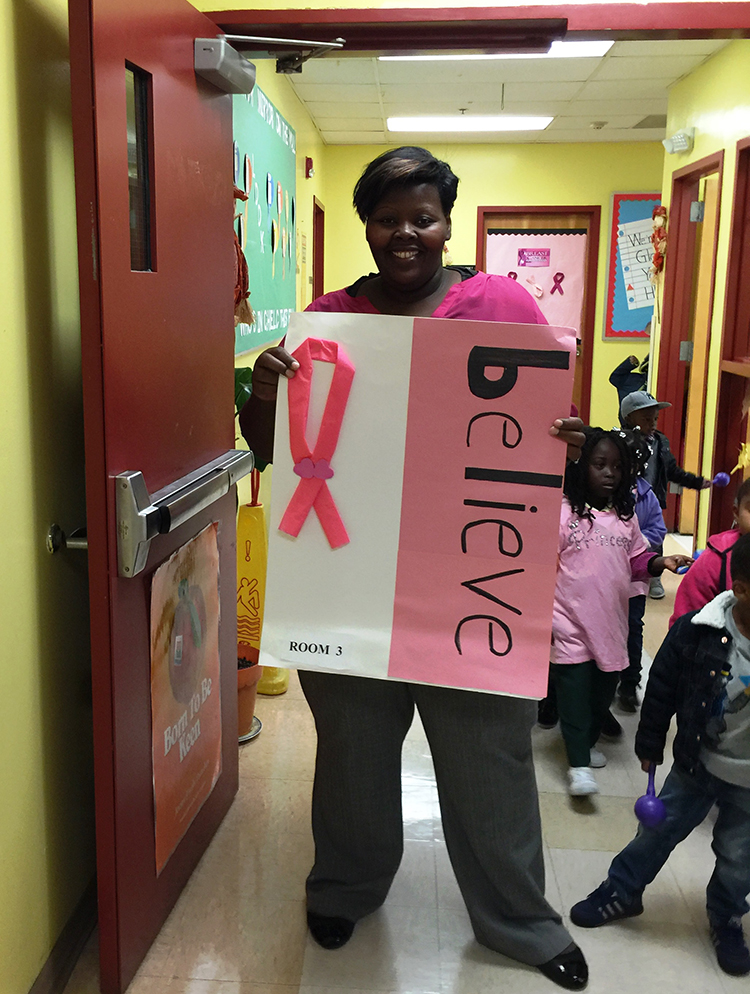 CHELC breast cancer teacher holding sign
