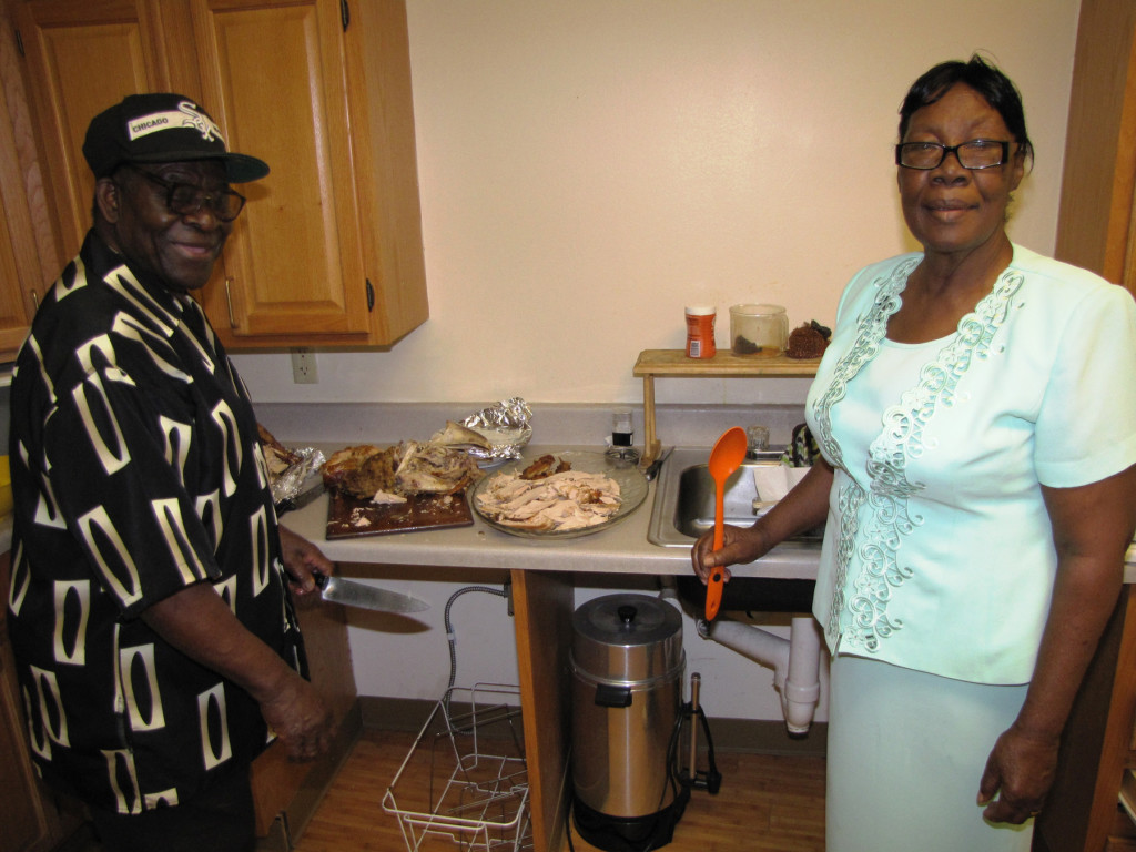George Wedderburn, left, and his wife, Rosalee, helped to prepare a Thanksgiving meal for the residents of Orange Senior.