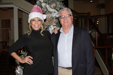 Television celebrity Wendy Williams, left, with New Community CEO Richard Rohrman, right.