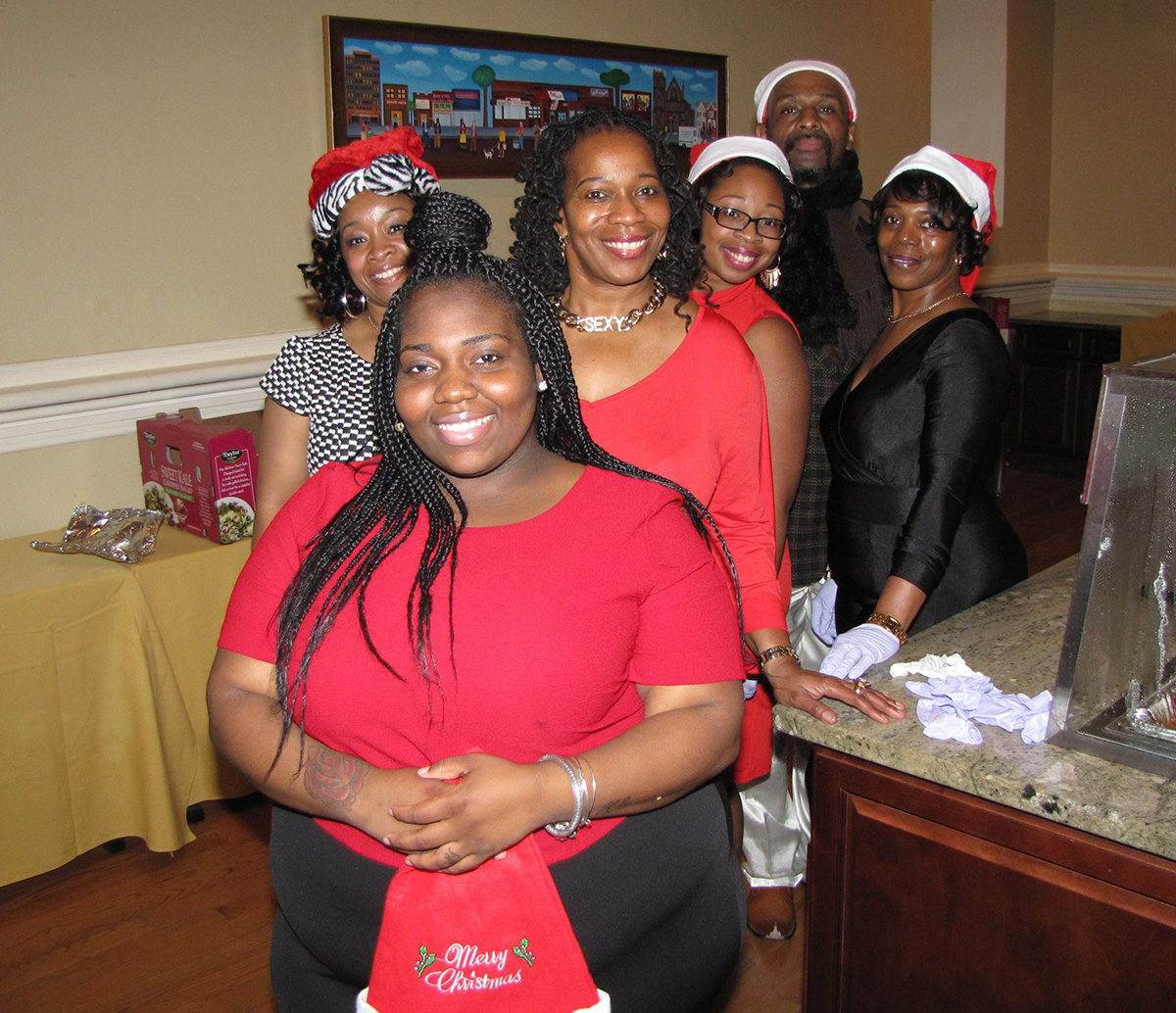 Fancy and out of uniform, members of the New Community Security Department dressed to impress for their holiday party.