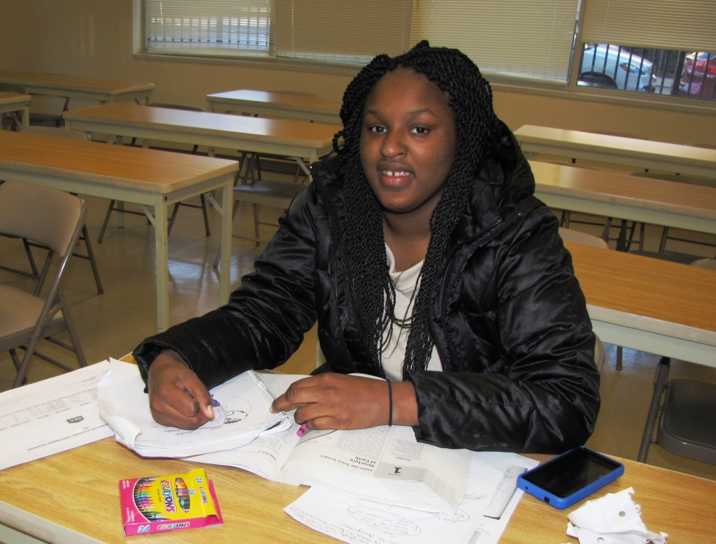 Selena Brown, 21, is a student of the Academic Enrichment program who is also a resident of New Community.