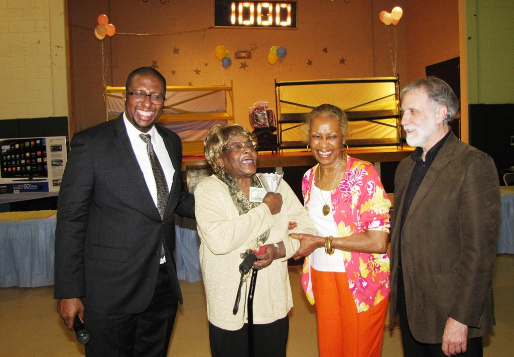 File photo from last year's Spring Festival of (from left) Edgar Nemorin, NCC board member; 50/50 cash raffle winner Gloria Harrison of New Community Commons Senior; Madge Wilson, NCC board member; and Richard Cammarieri, director of special projects.