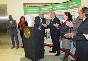 Richard Rohrman, at podium, CEO of New Community, introduced U.S. Sen. Robert Menendez, to the right.