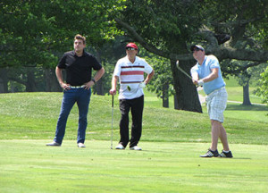 Robert Shawah, center, one of this year's golf outing  co-chairs, during the 2015 golf fundraiser.