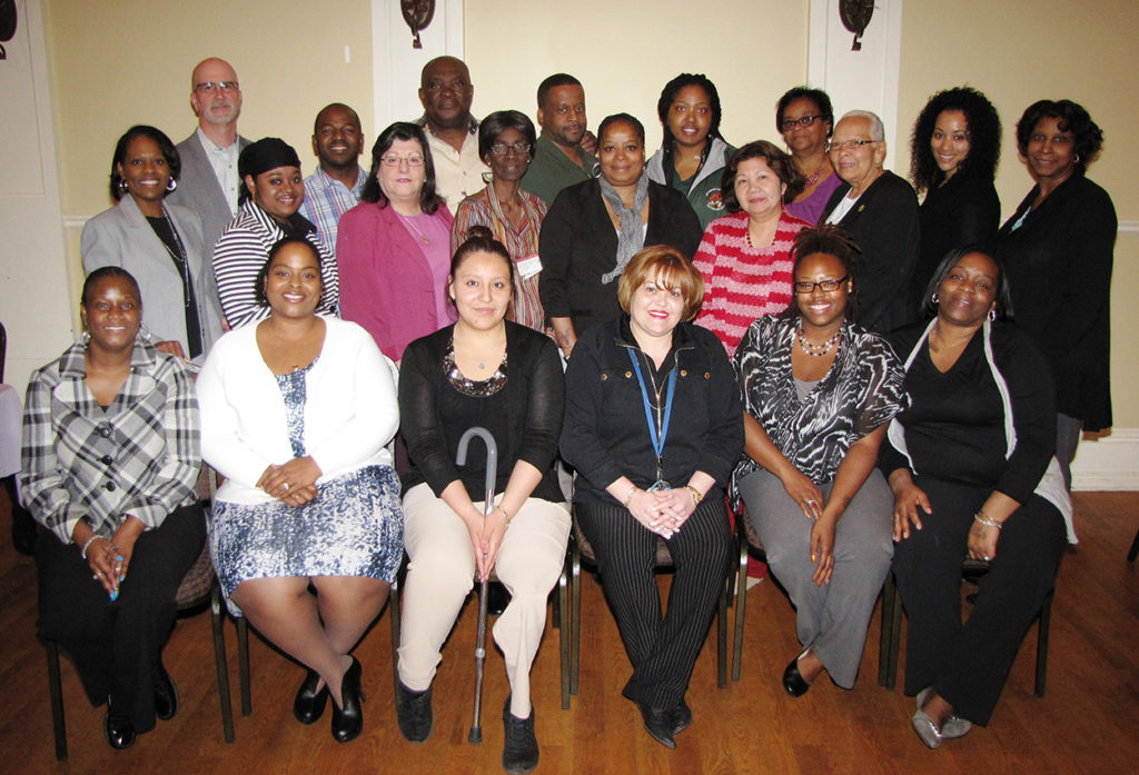 Bottom row, from left: Anna Sing-King, Human Resources; Nelly Payen, CHELC; Elisabeth Barahona, Harmony House; Migdalia Serrano, LaToya Bass; Workforce; and Patricia Washington, Workforce. Middle row, from left: Frances Teabout, Mission; Trudiann Clement, Brenda Buesing, Human Resources; Madeline Miller, Extended Care; Delores Bynum, Extended Care; Debbie Rohrman, Administration; Migdalia Martinez, NCC board member; Lesley Andujar, Human Resources; and Jill Derios, Extended Care. Back row, from left: Ben Galvez, Human Resources; Carlos Galley, Extended Care; Amos Obuamah, Extended Care; Tyrone Green, CHELC; Tangula King, HHELC; and Martha Davis, Workforce. Not pictured but in attendance: Helen Abraha, Administration.