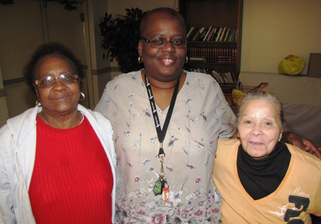 Doreatha Wertz, center, is a care coordinator at New Community Commons Senior, where she assists residents such as Madelyn Derrick, left, and Alma Rivera, right.