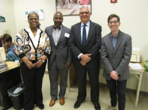 Rodney Brutton, second from left, director of Workforce Development, and New Community CEO Richard Rohrman, third from left, with visitors touring NCC's Financial Opportunity Center.