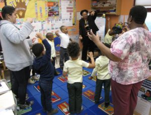 "Pre-kindergarten students in Room 1 at Community Hills Early Learning Center stretch out an imaginary ball of ""goop."""