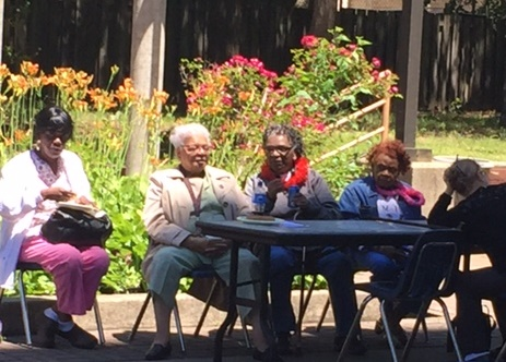 Residents of Douglas Homes enjoy sunny weather on the back patio and garden. Photos courtesy of Donnette Burrowes-Williams.