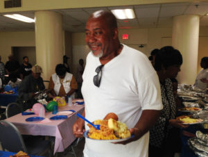 Residents enjoyed the luncheon, which featured fried chicken, cornbread, macaroni spaghetti, and more, and also participated in raffle drawings.