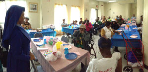 Residents of New Community Gardens Senior gathered to celebrate both Father's and Mother's Day at a luncheon organized by Health and Social Services.
