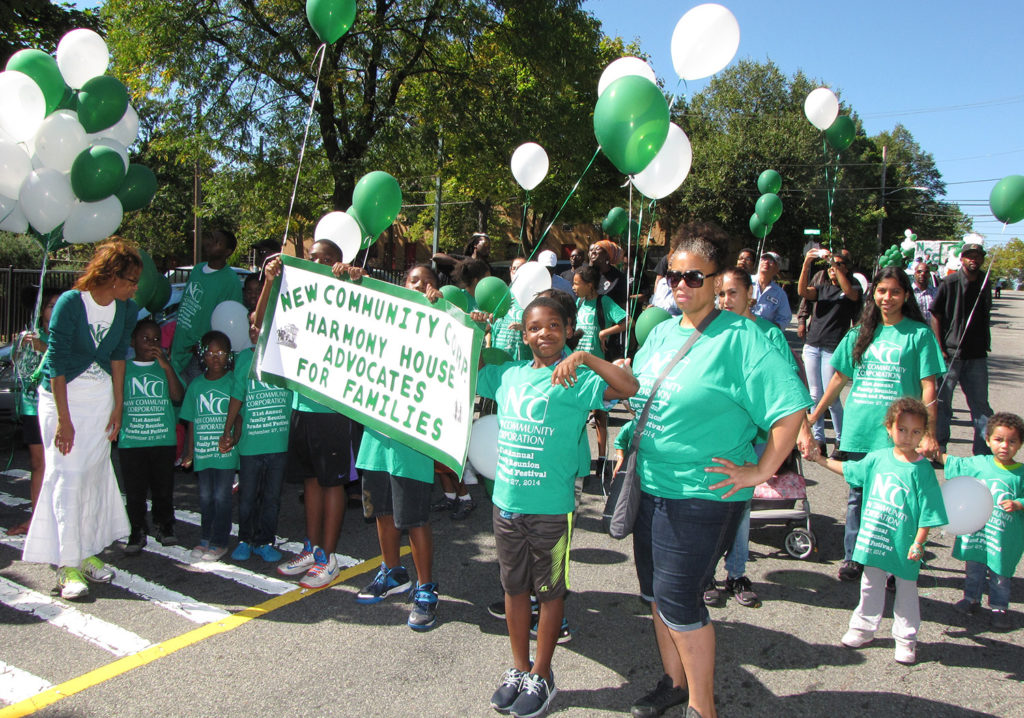 File photo of 2015 parade marchers from Harmony House, a transitional housing facility for homeless families.