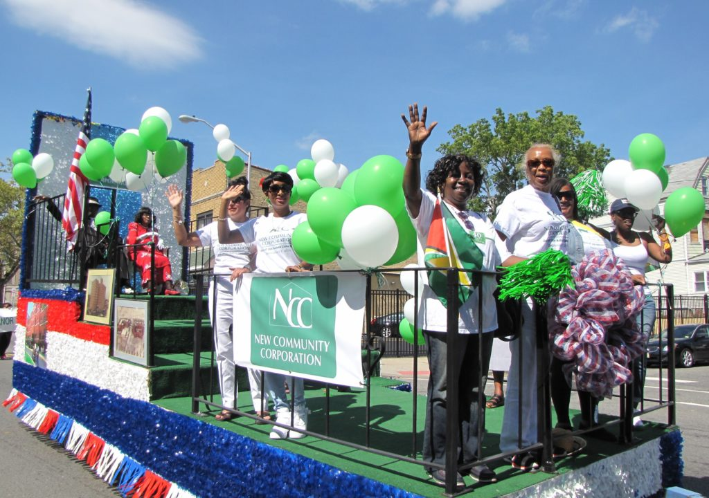 New Community's departments of Property Management and Health and Social Services led the parade line-up by representing the first of NCC's developments: housing.