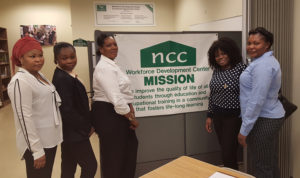 A file photo of graduates from the Allied Health Training Program at the New Community Workforce Development Center.