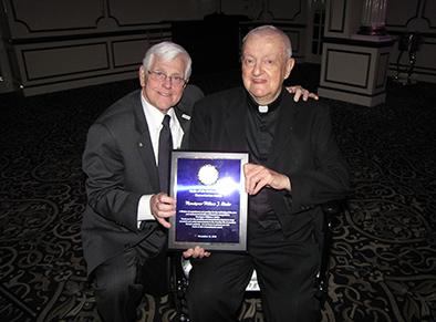 Dr. Jim Oleske, left, founder of the Circle of Life Children's Center, with Monsignor William J. Linder, founder of New Community, who was awarded the Humanitarian Award.