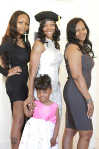 From left: Shannon Murray, sister; Tyana Murray, Deborah Walker, mother. Front center is Tahyae Fisher.