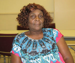 Walterine Hatton assists fellow residents of New Community Manor Senior and helps  keep her building clean.
